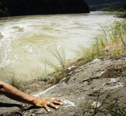 rock beside river, crop for blog